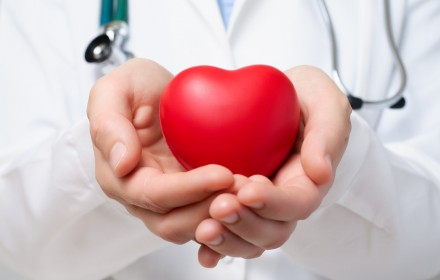 Doctor protecting a heart