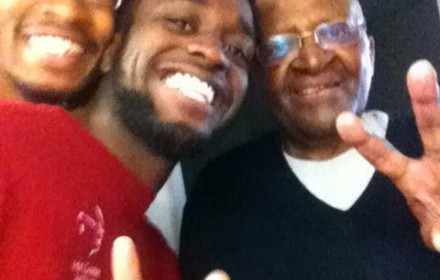 Miller and Thompson pose for a selfie with Archbishop Desmond Tutu