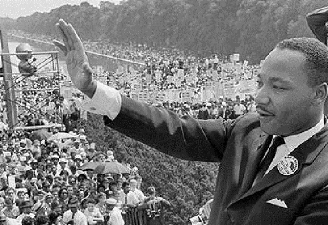 """(FILES) US civil rights leader Martin Lu...(FILES) US civil rights leader Martin Luther KIng waves to supporters 28 August 1963 from the Lincoln Memorial on the Mall in Washington DC during the """"March on Washington"""". On the steps of the Lincoln Memorial, King delivered his """"I Have a Dream"""" speech, which is credited with mobilizing supporters of desegregation and prompted the 1964 Civil Rights Act. 28 August, 2003 marks the 40th anniversay of the speech. King was assassinated on 04 April 1968 in Memphis, Tennessee by James Earl Ray, who confessed to the shooting and was sentenced to 99 years in prison. AFP PHOTO/FILES (Photo credit should read -/AFP/Getty Images)"""