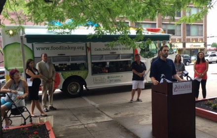 Chief Program Officer Mitch Gruber discusses the third Curbside Market vehicle and the Double Up Food Bucks program Aug. 16 at Andrews Terrace in Rochester.