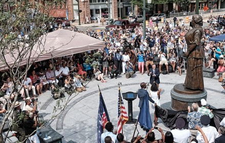 Cheers arise from the crowd of hundreds after the statue of Maggie L. Walker is unveiled at a ceremony last Saturday at the plaza at Broad and Adams streets. PHOTO: Richmond Free Press