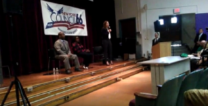 L to R: County Legislator James Sheppard, Mayor Lovely Warren, and Rachel Barnhart participate in a mayoral debate in June.