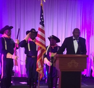 Bing Reaves, Sr. (a Black Heritage Pioneer Honoree and also served in the U.S. Army) leads the Fallen Soldier Tribute with Buffalo Soldiers as Color Guard.