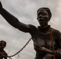 (The Equal Justice Initiative opened the National Memorial for Peace and Justice on April 26 near its headquarters in Montgomery, Alabama. Visitors see Ghanaian artist Kwame Akoto-Bamfo's sculpture when they walk into the memorial. Photo: CNN)